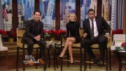 Kelly Ripa  - nice legs - leather miniskirt caps - Dec 18 2013