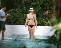 Molly Sims - wearing a bikini in Miami 12/24/13