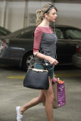 Taylor Swift - looking busty and leggy in tight top and shorts while shopping in Los Angeles CA 01/17/14