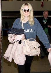 Dakota Fanning - at LAX Airport 1/28/14