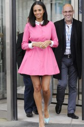 Alesha Dixon leggy in pink dress with slight pokies as she leaves her hotel and also poses with a fan 1/17/13
