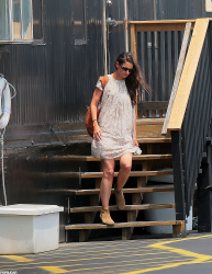 Katie Holmes dress gets partly caught up in the wind as she boards a helicopter 6/1/12
