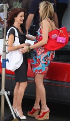 Katie Cassidy in colorful summer dress on the slighty windy set of �Melrose Place� 8/10/09