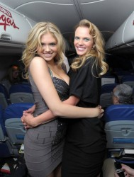 Kate Upton resting a glass between her boobs on the SI Swimsuit Issue NY To Vegas Flight 6/14/12