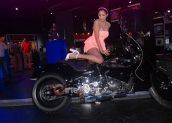 Poonam Pandey upskirt in very short pink dress on a motorcycle at the Stuff Gadgets Show at MMRDA Grounds in BKC 11/2/12