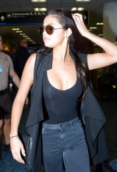 Selena Gomez at the Airport in Miami on July 12, 2014
