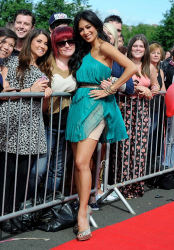 Nicole Scherzinger in a short green dress flashing her nude colored slip at the Newcastle auditions of the X Factor 6/18/12