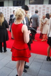 Evanna Lynch in a short red dress at the Jameson Empire Awards 3/25/12