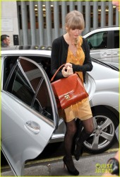 Taylor Swift leggy in pantyhose at the Kiss 100 Radio studio in London 2/21/13