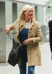 Kirsten Dunst Catching a flight out of Heathrow 08-27-2014