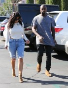 Kim Kardashian - Wearing Open-Back Shirt leaving a Movie Theater in Calabasas 10/19/14