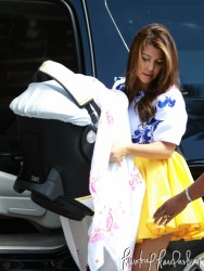 Kourtney Kardashian arriving at the Eden Roc Hotel in a yellow skirt 10/11/12